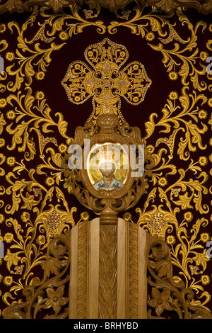 Detail of sculpture of wooden jesus christ crucified on cross stock jesus christ drawing in holy temple wooden entrance door detail red cloth with golden thread patterns altavistaventures Gallery