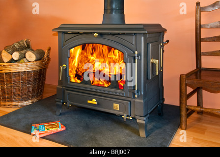 woodburning stove and a basket of logs stock photo royalty free image 36643537 alamy. Black Bedroom Furniture Sets. Home Design Ideas