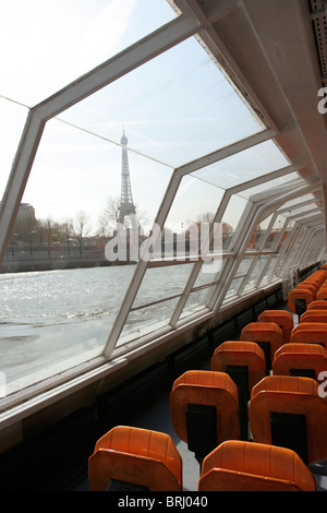 View of Eiffel Tower from a cruise boat. - Stock Photo