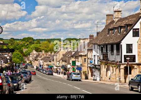 View looking down the High Street in the tourist Cotswold town of Burford, Oxfordshire, England, UK - Stock Photo