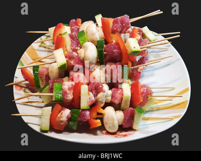 Raw grill sticks with meat and vegetables are ready for cook. - Stock Photo