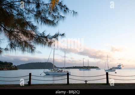 Docked boats in vila bay with Iriki island in the background, taken along the footpath which runs parallel to the - Stock Photo