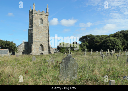 Overgrown grass in the old graveyard at St Uny's Church in Lelant, Cornwall UK - Stock Photo