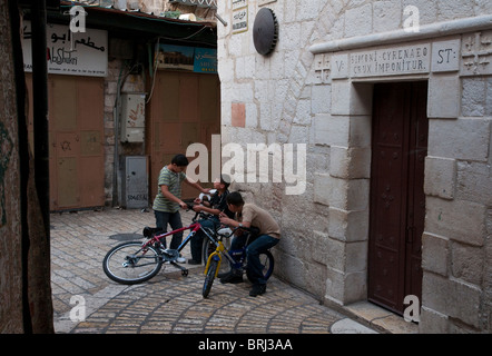 Israel. Jerusalem Old City. Via Dolorosa. Station V. Palestinian children playing in the street. - Stock Photo