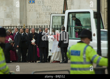 Pope Benedict XVI  arrives in Popemobile outside Westminster Abbey. He is greeted by  Roman Catholic Archbishop - Stock Photo