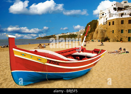 boat on Albuferia Beach,Albufeira,Algarve,Portugal,Europe - Stock Photo