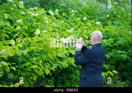 A Garda playing a trumpet in Ireland - Stock Photo