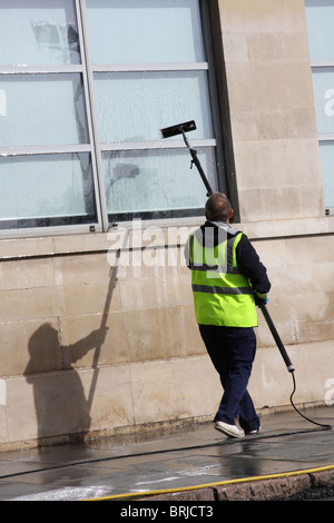 A window cleaner in a U.K. city. - Stock Photo