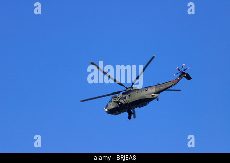 A Royal Navy  Westland Sea King HC.4 Helicopter flying over London, England, UK - Stock Photo