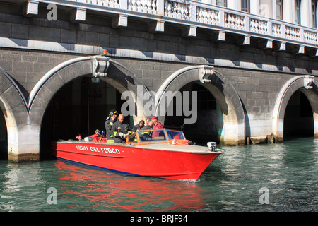 Venetian firefighters in a Vigili del fuoco (fire boat) at the fire department of Venice, Italy