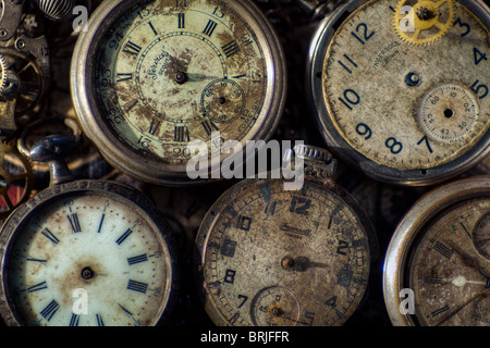 Broken old pocket watches and parts - Stock Photo