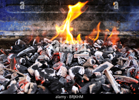 Burning charcoal on barbecue grill - Stock Photo
