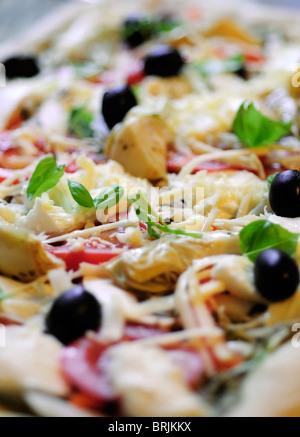 Uncooked toppings on fresh pizza, close-up - Stock Photo
