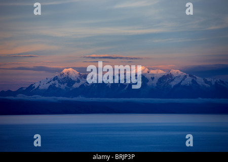 the Cordillera Real in the Andes from Lake Titicaca, Bolivia - Stock Photo