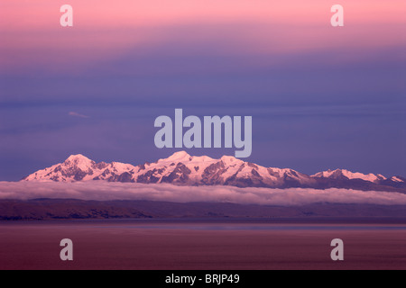 the Cordillera Real in the Andes from Lake Titicaca at dusk, Bolivia - Stock Photo