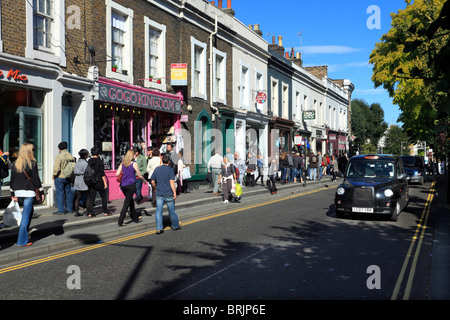 Shopping in Notting Hill Gate London - Stock Photo