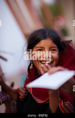 a girl at a weaving school in Sucre, Bolivia - Stock Photo