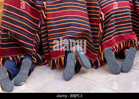 feet of boys at a weaving school in Sucre, Bolivia - Stock Photo