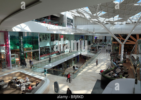 Inside Westfield shopping centre in London - Stock Photo