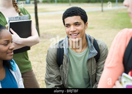 Teenage boy with high school friends, portrait - Stock Photo