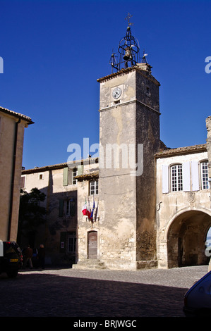 Luberon France : The village of Menerbes,belfry and City Hall - Stock Photo