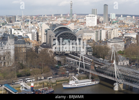 Birds-eye-view of Charing Cross railway station, Hungerford Bridge, and Golden Jubilee Bridges from the London Eye - Stock Photo