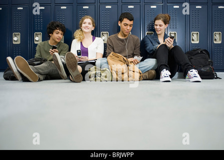 High school students hanging out in school corridor - Stock Photo