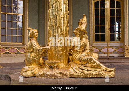 Gilded statues in the Chinese teahouse, Sanssouci gardens, Berlin, Germany - Stock Photo