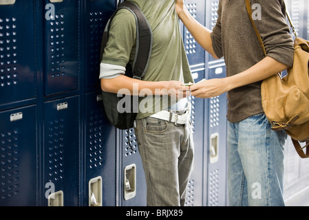 Teenage boy bullying classmate and stealing his money - Stock Photo