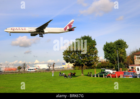 Low flying passenger aircraft  landing at Heathrow  airport, London - Stock Photo