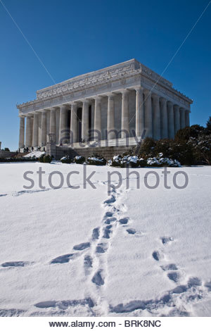 Footsteps in the snow lead to Abraham Lincoln Memorial in winter. - Stock Photo