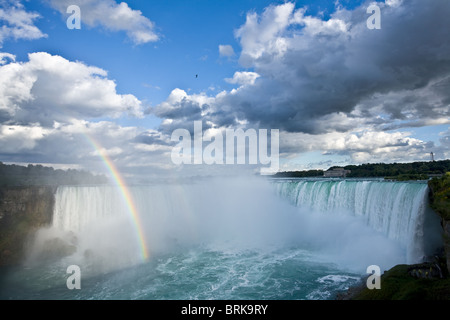 Rainbow and spectacular clouds over Horseshoe Falls, Niagara Falls, Ontario, Canada - Stock Photo