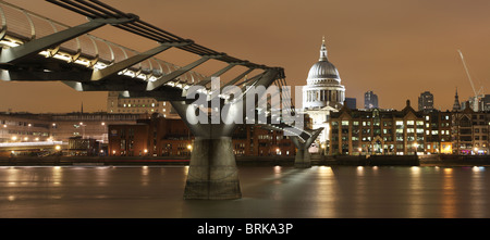 StPauls Cathedral and Millenium bridge at night and thames river - Stock Photo