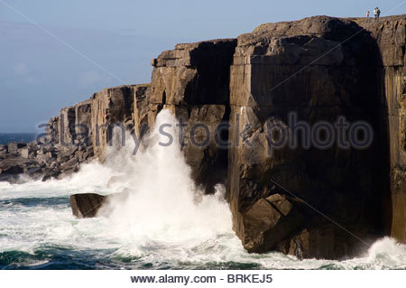 Waves crashing against rocks at The Burren, County Clare - Stock Photo