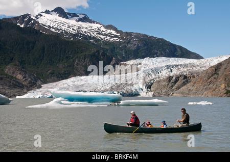 Family in canoe at Mendenhall Glacier near Juneau Alaska USA - Stock Photo