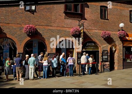 Visitors outside Jorvik Viking Centre entrance in summer York North Yorkshire England UK United Kingdom GB Great - Stock Photo