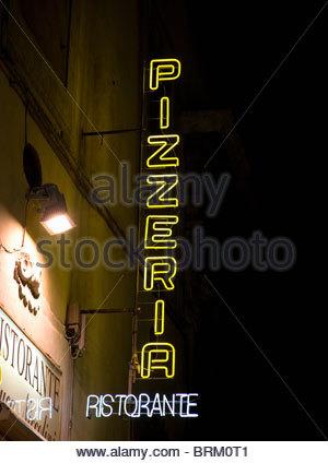 Neon Restaurant sign at night - Stock Photo