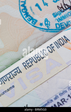 Indian visa in a british passport with immigration stamp - Stock Photo