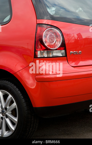 Close up view of rear light and plastic bumper on a volkswagen polo car. - Stock Photo