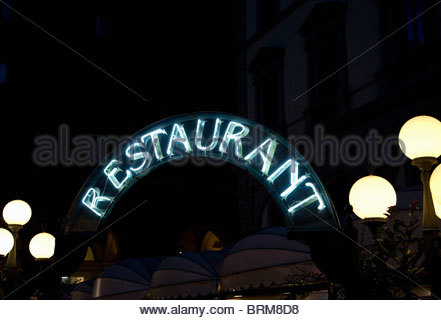 Neon Restaurant sign at night - Stock Photo