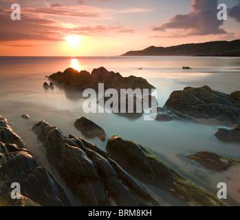 Sunset on Barricane Beach, Woolacombe, Devon, England. Summer (June) 2010. - Stock Photo