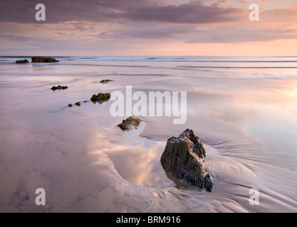 Rockpools on sandy Combesgate Beach at sunset, Woolacombe, Devon, England. Summer (June) 2010. - Stock Photo