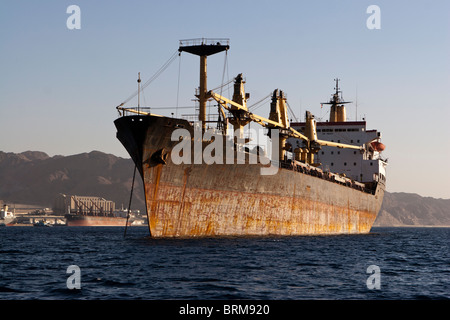 Cargo ship Asha Ashik at anchor in the Gulf of Aqaba, Jordan. - Stock Photo