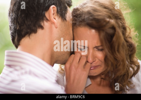 Man consoling a woman - Stock Photo