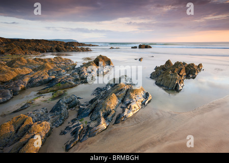 Low tide at sunset on Combesgate Beach at Woolacombe, Devon, England. Summer (June) 2010. - Stock Photo