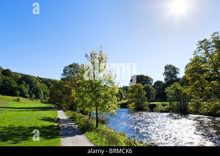 Dales Way path alongside the River Wharfe near the Cavendish Pavilion, Bolton Abbey, Wharfedale, Yorkshire Dales, - Stock Photo