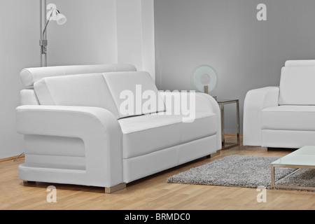 A studio shot of white furniture - Stock Photo
