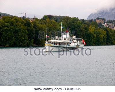 The Paddle Steamer Blumlisalp on Lake Thun, Bernese Oberland. Switzerland - Stock Photo