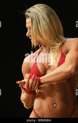 Female Bodybuilder showing off her muscles Stock Photo ...