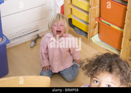 Brat child giving a toddler tantrum at toddler group - Stock Photo